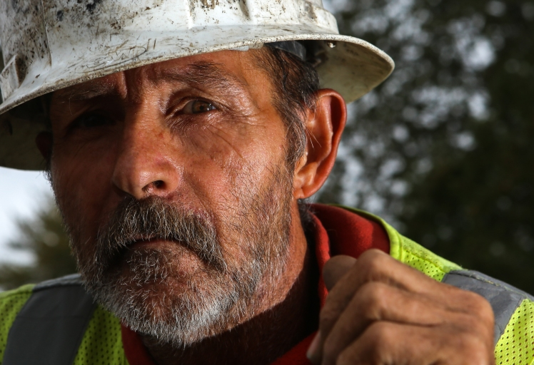 Don Battle of Weidman, looks on for a portrait while on the site of a project, demolishing old East Campus Drive in Mt. Pleasant, Mich. Battle has spent more than 40 years as a laborer in Isabella County. Building mostly bridges he has completed 35 in the area.